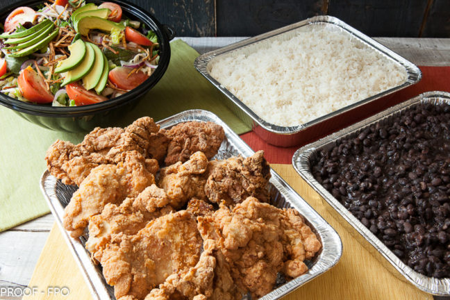 Classic Platos: choice of protein, garlic coconut rice, black beans and salad